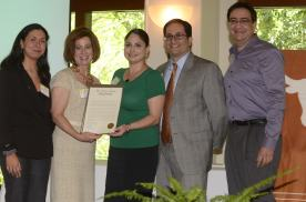 Dr. Glessner is presented a legislative proclamation at the 2012 Exemplary Migrant Student Recognition Ceremony.