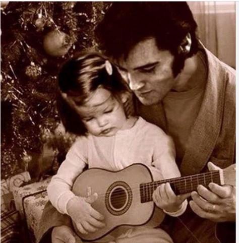 Elvis teaching Lisa to play guitar