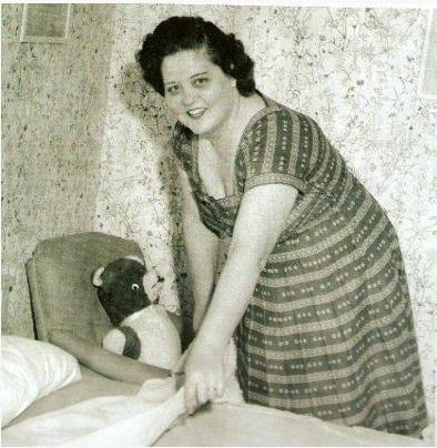 Gladys making Elvis' bed