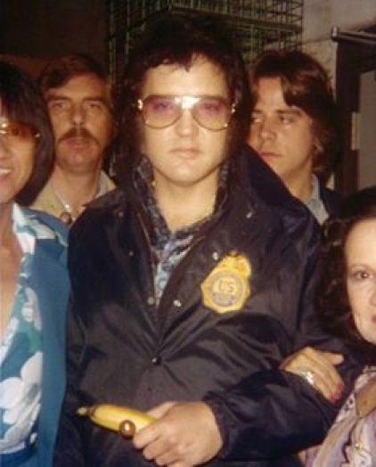 Elvis with Federal badge on jacket.