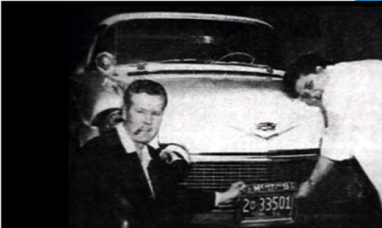 Elvis' parents with his car tag