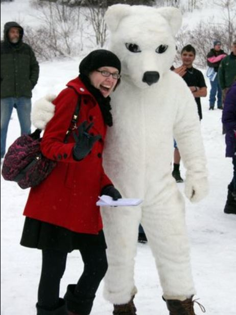 Libby Cudmore as a reporter. interviewing Goody The Polar Bear at the annual Goodyear Lake Polar Bear Jump