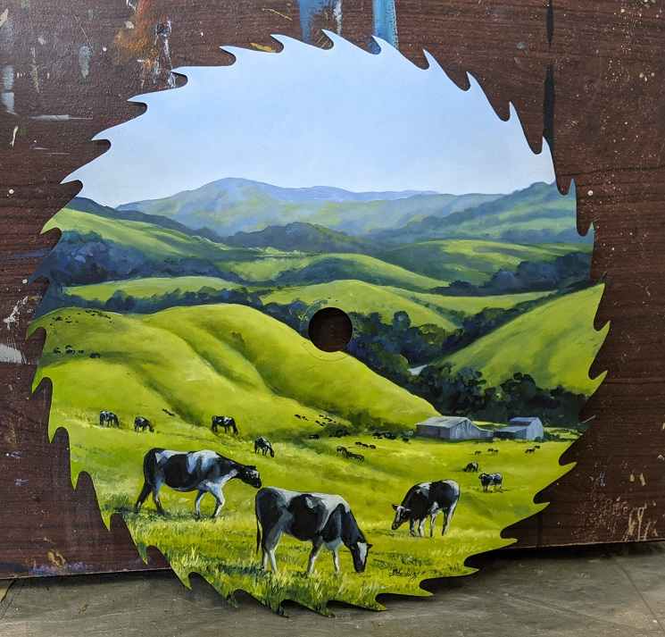 Commissioned rural scene painted on clients own sawblade