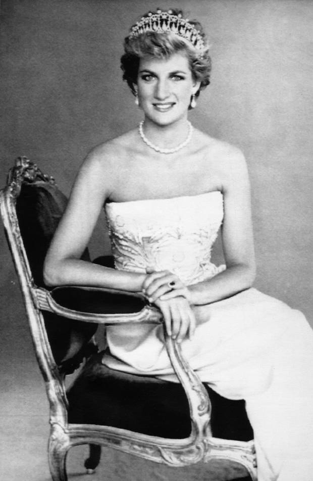 Princess Diana sitting on chair