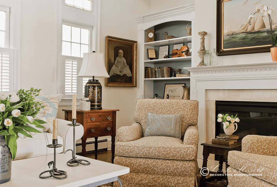 A coastal home in Duxbury, MA filled with antiques and comfortable arm chairs in front of the fireplace. Interior Design Portfolio