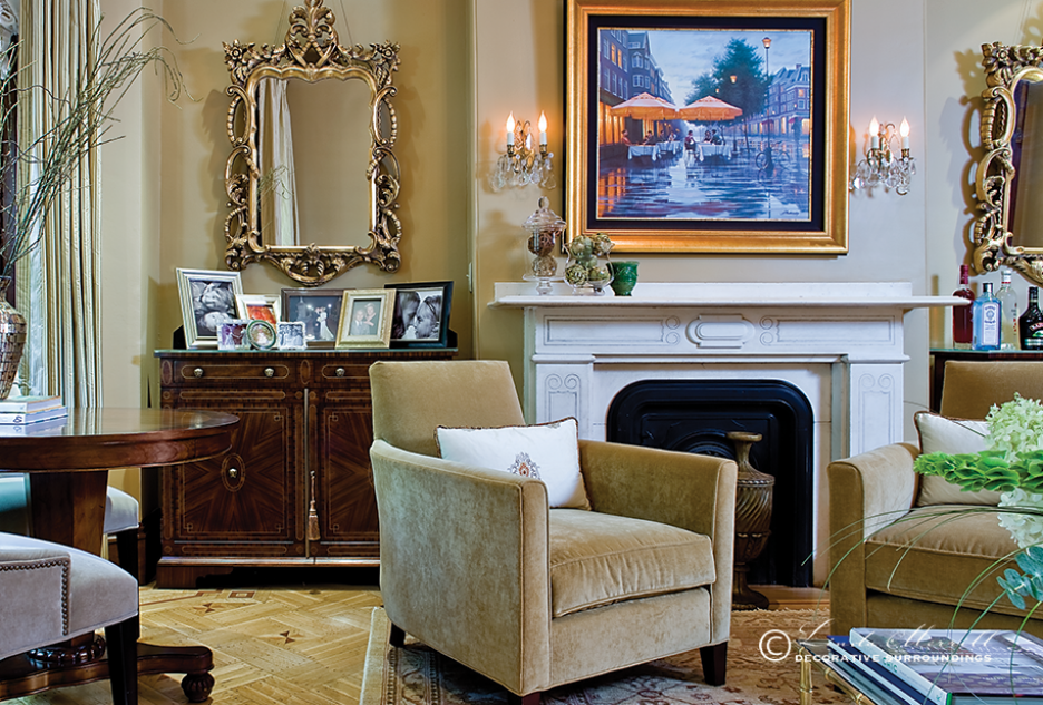 Design by Linda Merrill Decorative Surroundings: A formal gold living room in a Boston townhouse filled with velvet chairs, fireplace, antique chandelier