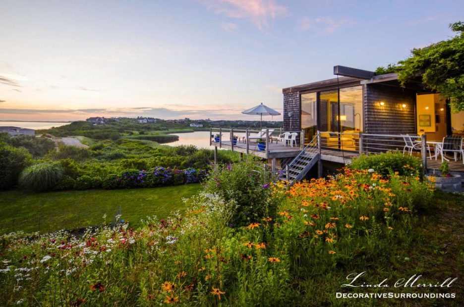 Modern Beach house overlooking a lawn of wildflowers, a small pond and the Atlantic Ocean.