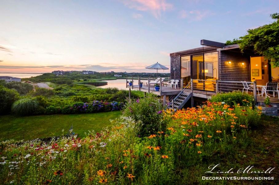 Beach house exterior in Truro, Massachusetts overlooking the Atlantic Ocean and wildflowers.