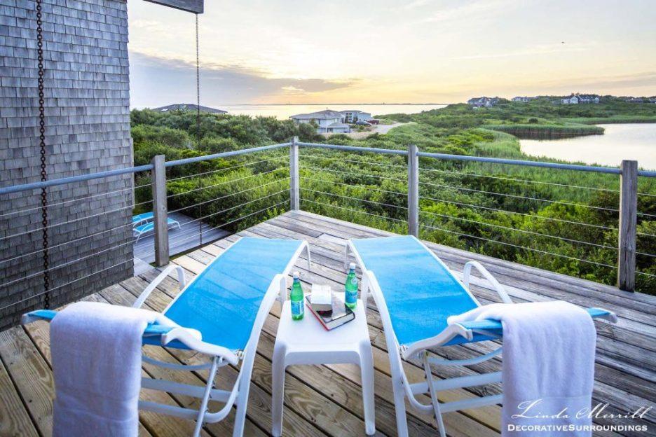 Modern Coastal House in Truro, Massachusetts blue deck chairs overlooking the Atlantic Ocean.