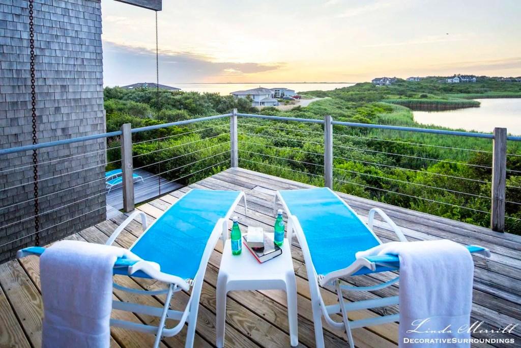 Modern beach house in Truro, Massachusetts blue deck chairs overlooking the Atlantic Ocean.