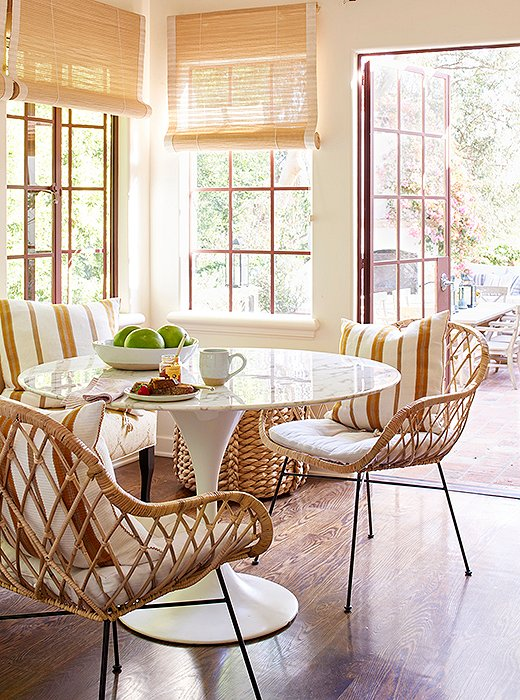 Home Again Movie breakfast nook Saarinen tulip table rattan chairs