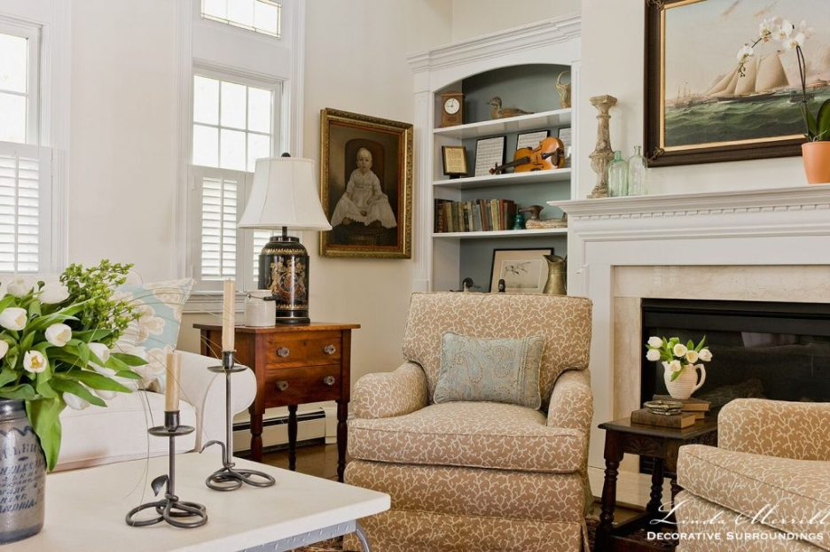Design by Linda Merrill Decorative Surroundings: Coastal Home living room in Duxbury MA with white sectional arm chairs antiques
