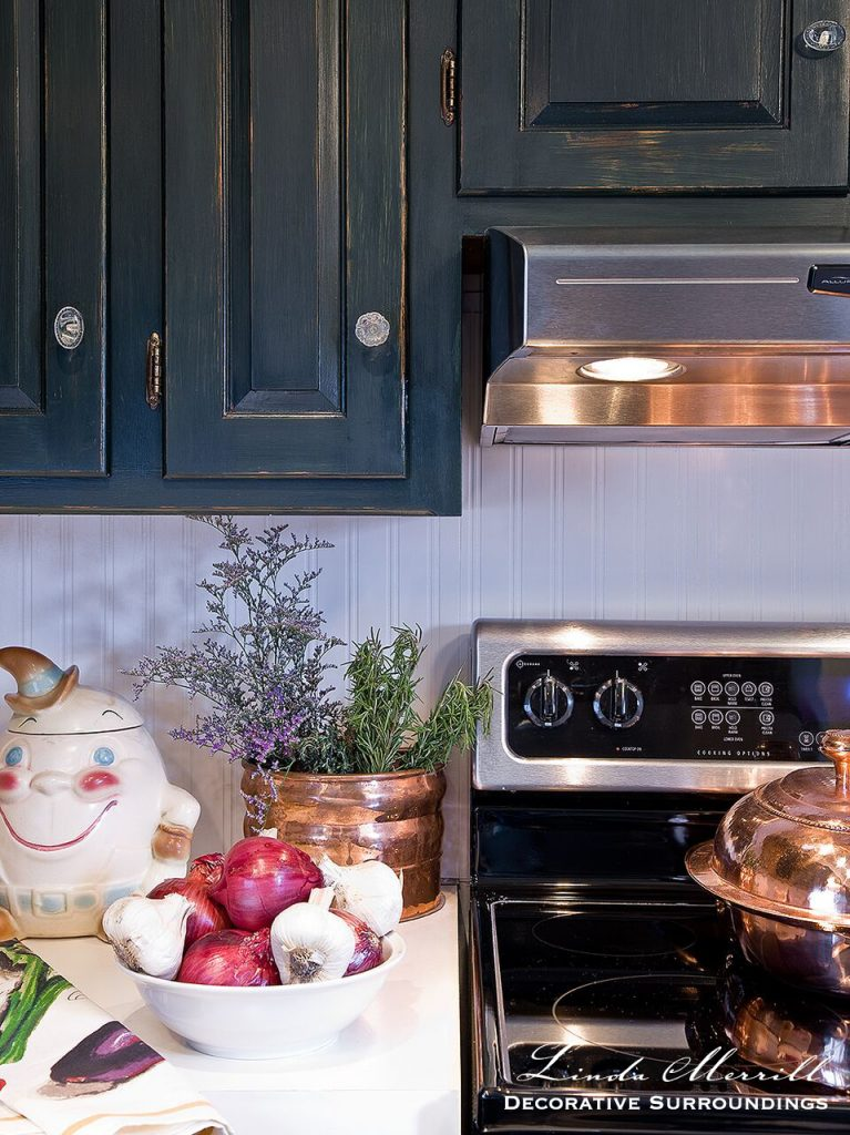 Design by Linda Merrill Decorative Surroundings: French country kitchen, copper pots, green painted cabinets, stainless steel appliances.