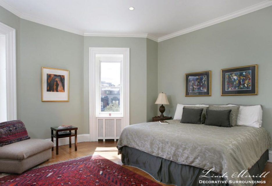 Design by Linda Merrill Decorative Surroundings: Back Bay Bachelor Penthouse bedroom with gray walls and bedding, red oriental carpet