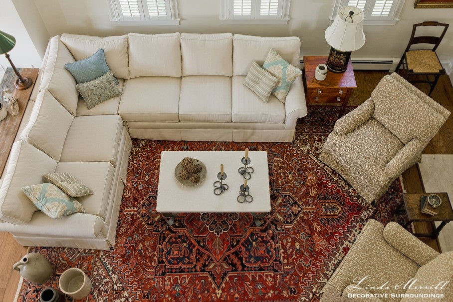 Coastal Home living room in Duxbury MA with white sectional arm chairs antiques red oriental carpet