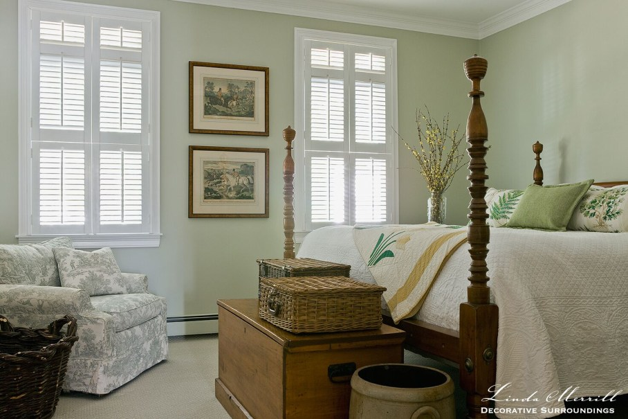 Coastal Home bed room in Duxbury MA with green walls, white bedding four poster antique bed shutters