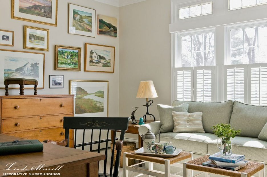 Design by Linda Merrill Decorative Surroundings: Coastal Home den in Duxbury MA with green sofa, fine art gallery wall