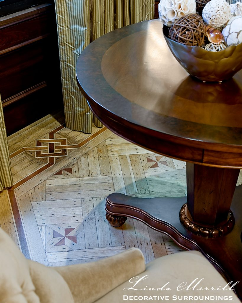 Design by Linda Merrill Decorative Surroundings: South End brownstone formal living room with gold walls and velvet furnishings, round table and parquet floor