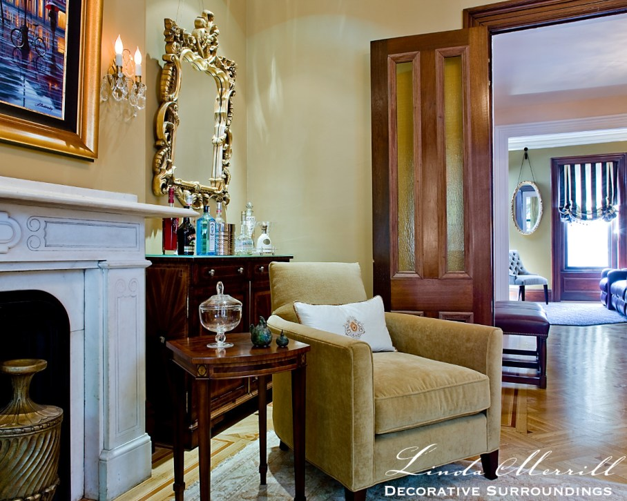 South End brownstone formal living room with gold walls and velvet furnishings