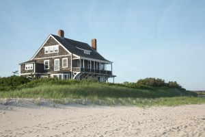 A shingle style beach house overlooking the beach and Atlantic ocean
