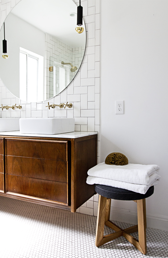Bathroom penny round tile floor, floating mid-century cabinet as vanity, round mirror