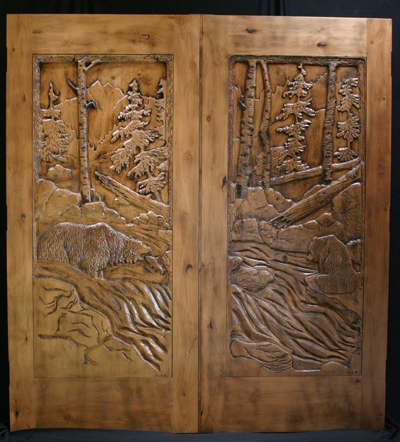 Carved wood door of woods and bears