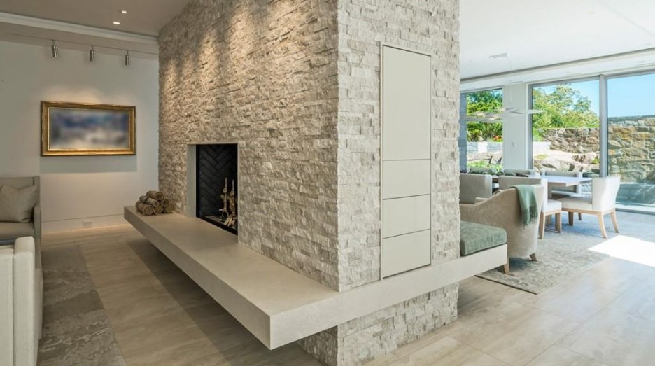 Spectacular oceanside modern beach house in Manchester-By-The-Sea Massachusetts. #modern #beach #coastal #home #oceanside #views #stone #glass #fireplace #double #fireplace