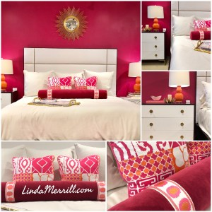 Pink and white bedroom, bright pink walls, white bedding, upholstered headboard, pink and orange accessories
