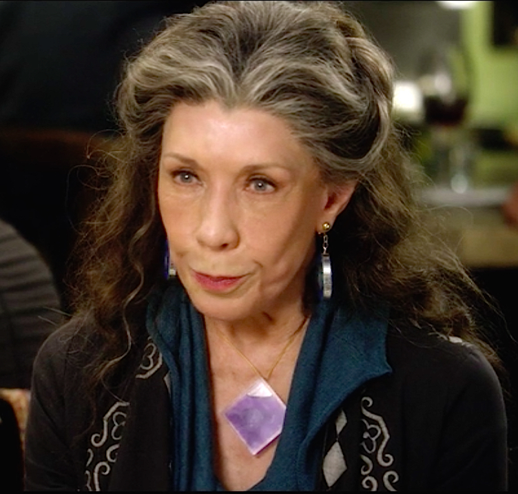 Grace and Frankie Lily Tomlin in purple quartz teal and black