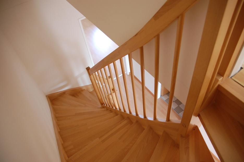 Narrow staircase white walls