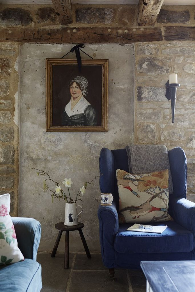 Tudor stone cottage bastle photography Brent Darby living room blue chair charming stone cottage