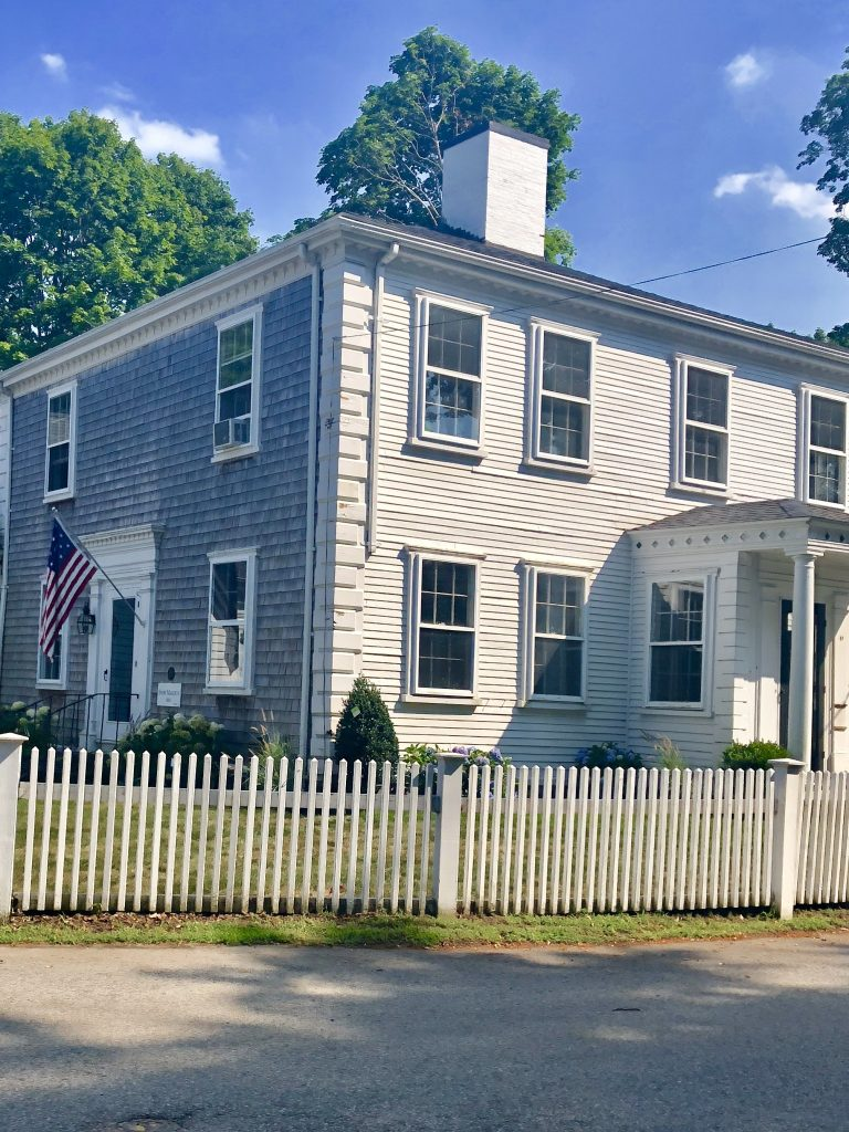 White clapboard shingle siding antique house American Flag July 4th Duxbury MA
