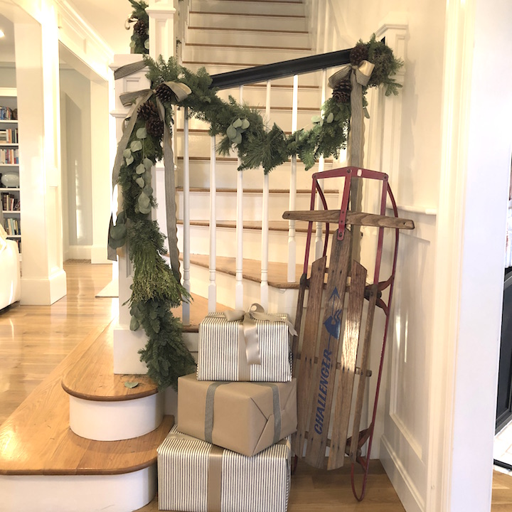 Pond Street stairwell garland sled wrapped packages Newburyport Christmas decorating house tour 2018