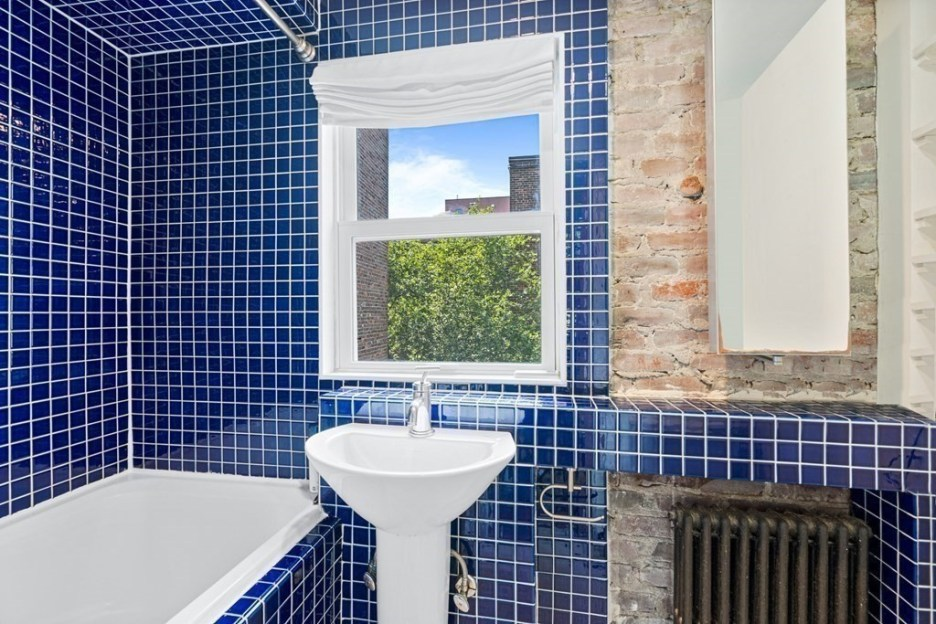 44 Hull St Boston Skinny House Spite House bathroom blue tile white fixtures 2nd floor