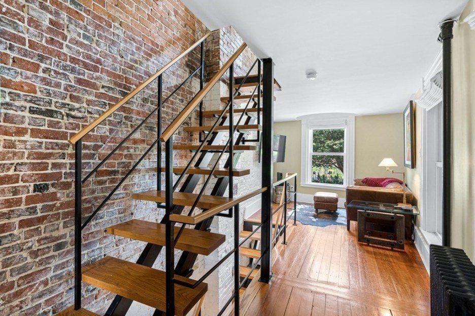 44 Hull St Boston Skinny House Spite House living room stairs and brick wall 2nd floor