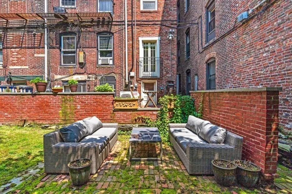 44 Hull St Boston Skinny House Spite House outdoor seating sofas