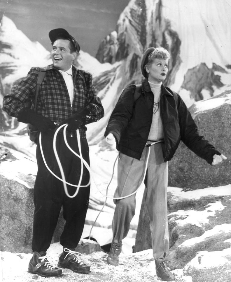 BW photo of Desi Arnaz and Lucille Ball in a skiing scene from I LOVE LUCY