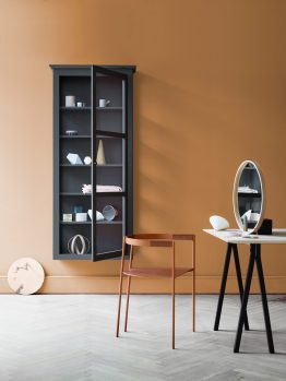 Image of Lindebjerg Design Color N4 Anthracite vitrine Cabinet in a orange colored creative room with interior