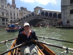 rowing under the Rialto Bridge