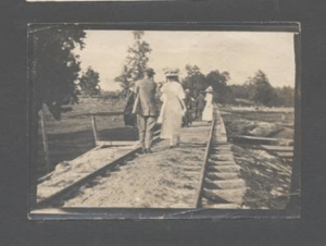Couple walking on RR Track