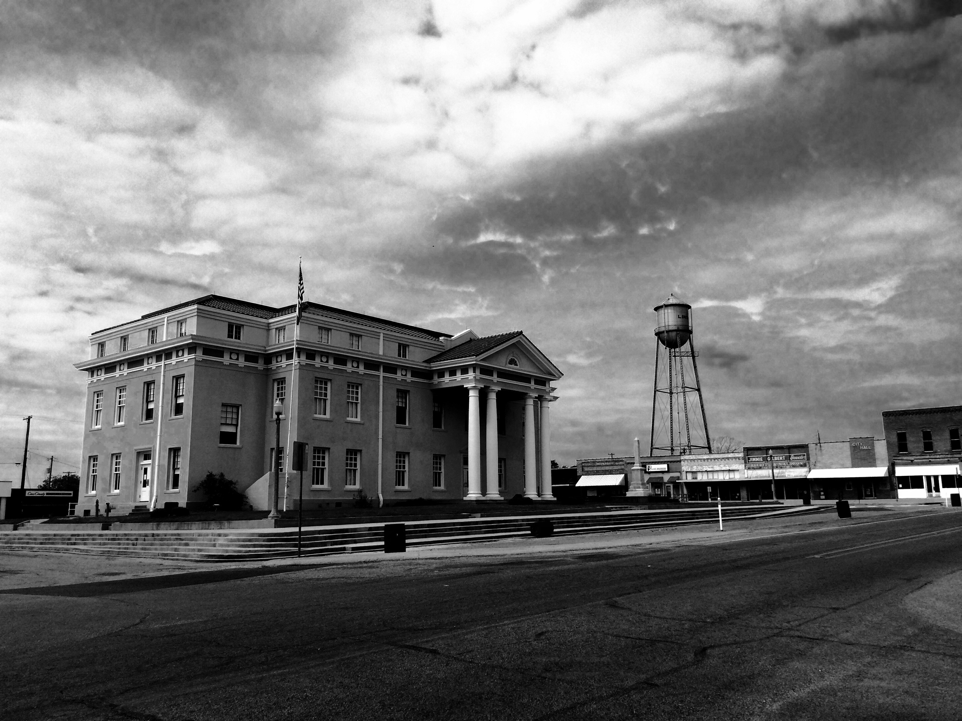 North and east faces of Cass County Courthouse with Linden's 1934 historic Water Tower in background
