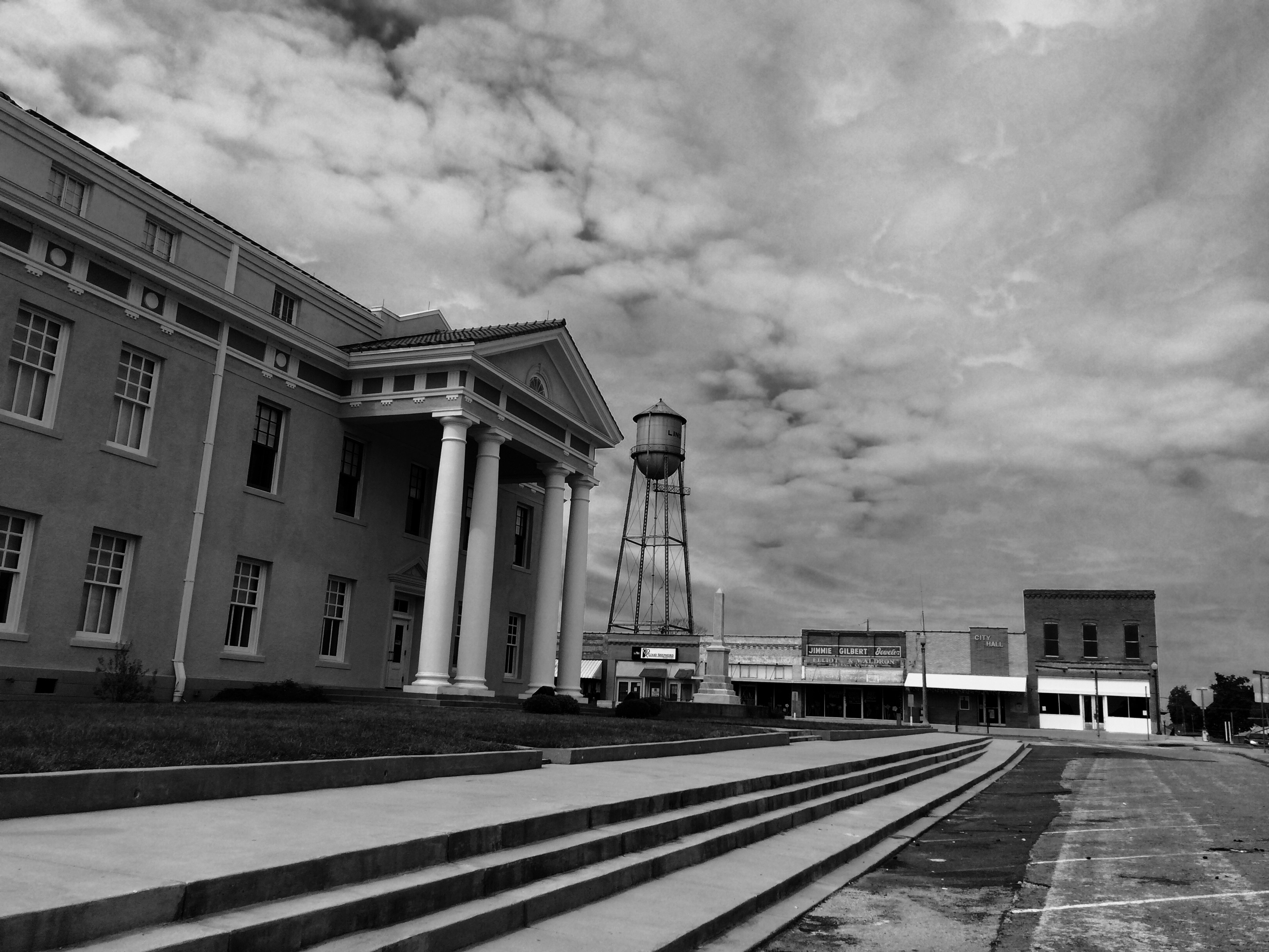North steps of Cass County Courthouse looking west toward Davis Drug building