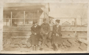 Solder with two women by RR depot
