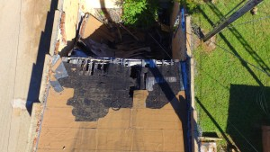 Arial view of collapsed section of roof on Linden Historic Firehouse. Photo courtesy of Kerry Wells.