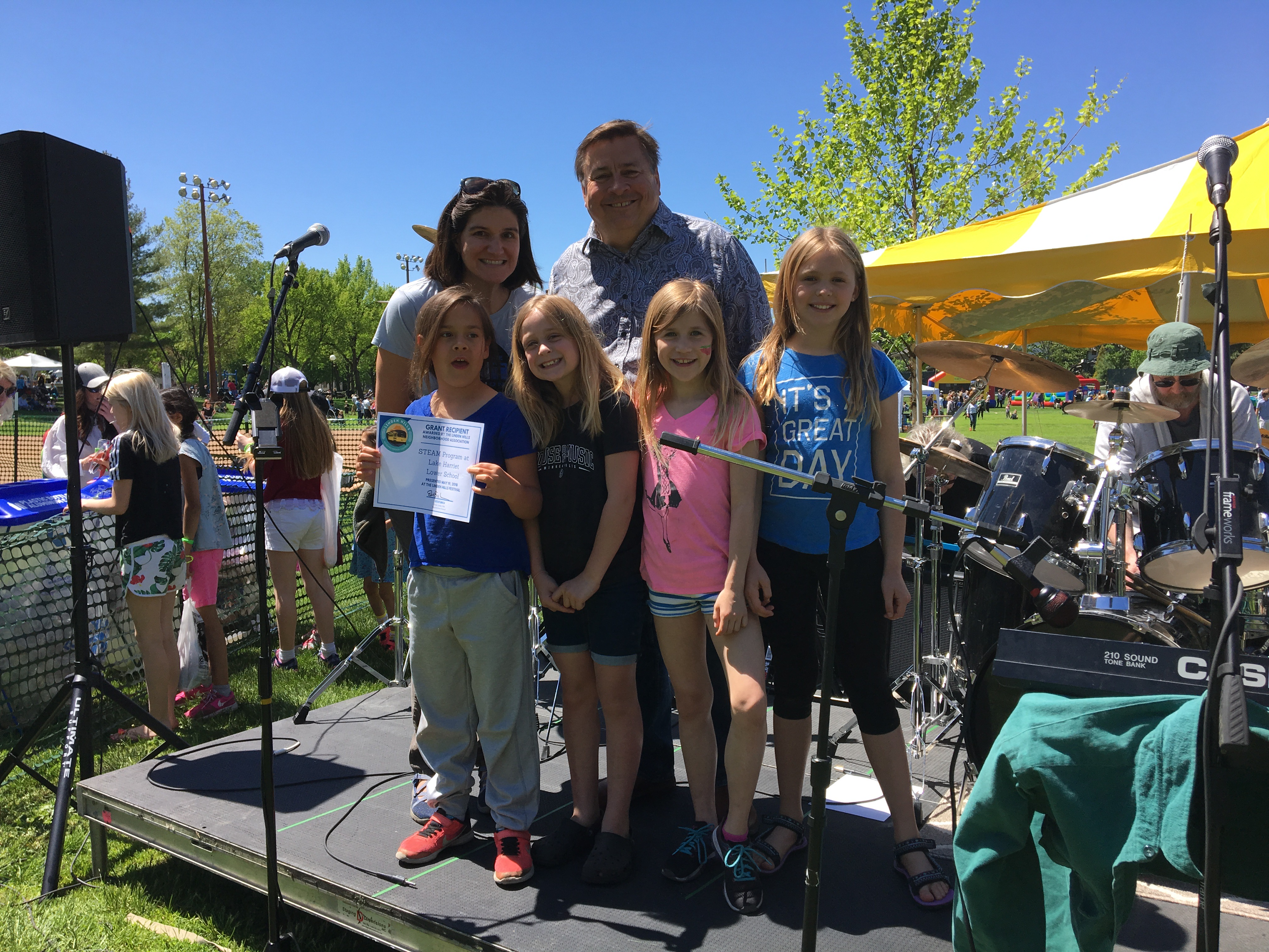 Family on stage at Linden Hills Festival