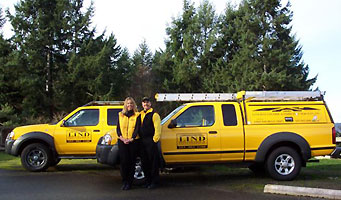 Lind Pest Control yellow service trucks side by side