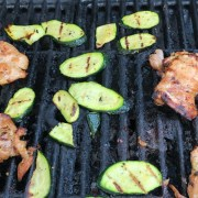Famous BBQ chicken thighs on the grill
