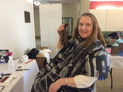 Faculty member donating hair to IC Hillel Inch-A-Thon