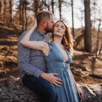 chelsea horton, CEO of Healing Embodied, wearing a blue dress having an intimate moment with her husband Matt