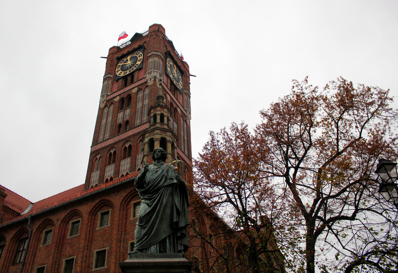 Nicolaus Copernicus statue in front of Torun's Clock Tower